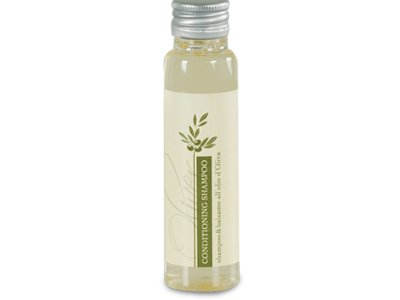 Shampoo balsamo agli estratti di Olio d'Oliva, giallo chiaro trasparente, in flacone 35ml, tappo in alluminio.