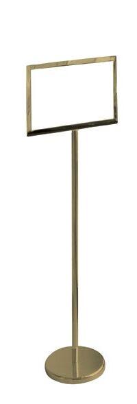 Piantana porta avvisi con struttura in acciaio ottonato, rifinitura lucida, tasca porta avvisi in plexi trasparente (l 34 x h 46 cm / l 46 x h 34 cm). Base zavorrata rotonda Ø 31 cm, asta a sezione rotonda Ø 3 h 114 cm.